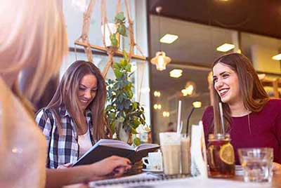 Friends laughing and looking at a menu