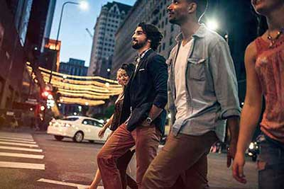 Group of friends crossing the street
