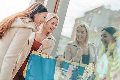 2 women window shopping