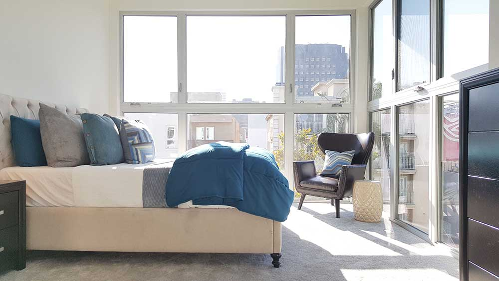 Bedroom with partial windowed walls