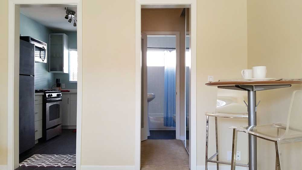 Interior studio apartment of kitchen and hallway to bathroom